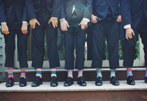 entrepreneurs in suits wearing different socks